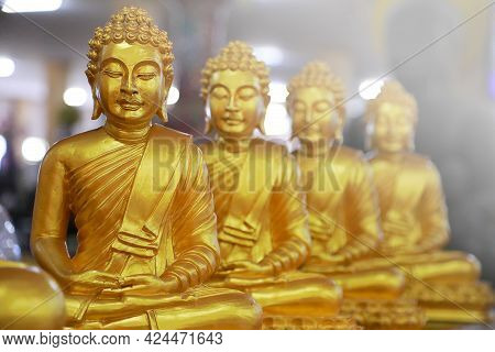 Group Of Golden Buddha Statue As Temple Background. Religions Concept.