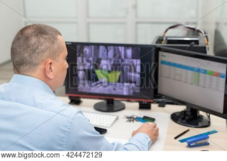 Security Guard Monitoring Cctv Camera In Security Room. Surveillance, Modern Technology Concept. Sel