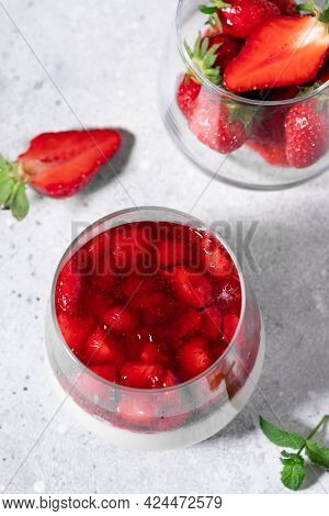 Top View Of Vegan Strawberry Panna Cotta On Gray Background. Traditional Italian Dessert. Vertical I