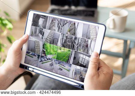 Man Monitoring Modern Cctv Camera On Digital Tablet Indoors. Surveillance Security System. Work From