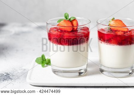 Vegan Coconut Panna Cotta With Strawberry Sauce In Glasses. Vegan Food Concept. Close-up, Copy Space