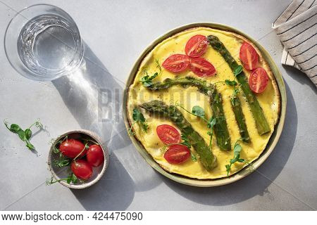 Italian Frittata With Asparagus, Tomatoes And Green Pea Microgreens On Gray Table. Healthy Breakfast