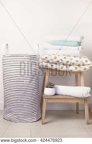 Laundry Basket Stack Of Towels And Pillows On Wooden Bench Household Chore Concept Minimal Vertical