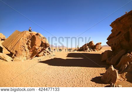 Group Of Travelers Visiting Group Of Amazing Rock Formations In Eduardo Avaroa Andean Fauna National