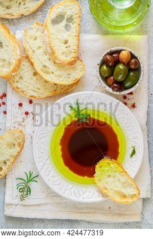 Freshly Baked Homemade Ciabatta And A Sauce Of Olive Oil And Balsamic Vinegar, Freshly Ground Pink P