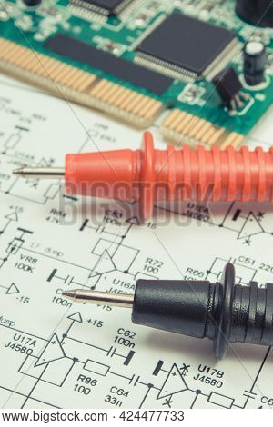 Printed Circuit Board With Transistors, Resistors, Capacitor. Diagram Of Electronics And Cable Of Mu