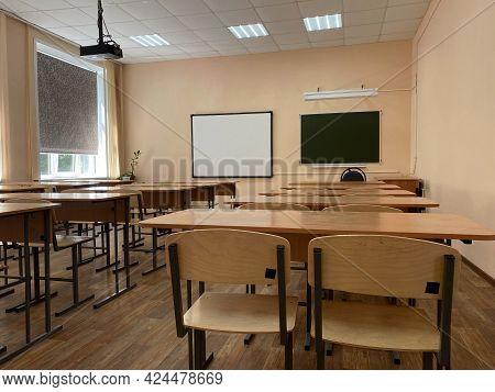 Empty Desks In A School Class Without Students In Beige Tones