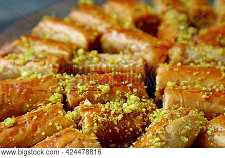 Closeup Rows Of Delectable Baklava Pastries Topped With Chopped Pistachio Nuts