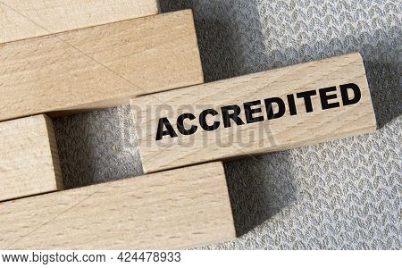 Accredited - Word On A Wooden Bar On A Gray Background. Business Concept