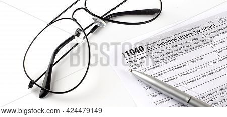 Blank Income Tax Forms. American 1040 Individual Income Tax Return Form. With Pen And Glasses