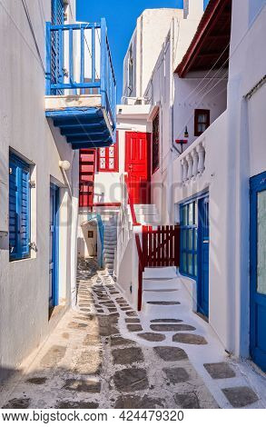 Beautiful Traditional Alleyways Of Greek Island Towns. White Walls, Colorful Balconies And Doors, Co