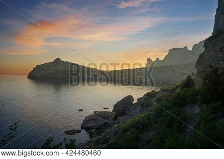 Sunset Over A Beautiful Bay On The Black Sea In Crimea In Russia. Cape Kapchik In The Evening Before