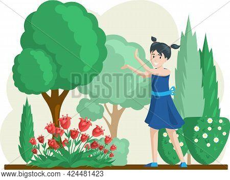 Girl Gardening Plants On Backyard Flowers On Beautiful Flower Bed, Enjoying Tulips And Roses In Spri