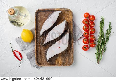 Raw Halibut Set, With Ingredients And Rosemary Herbs, On White Stone Table Background, Top View Flat