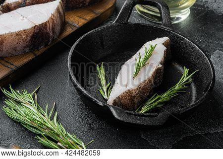Sliced Halibut Fish Set, With Ingredients And Rosemary Herbs, On Black Dark Stone Table Background
