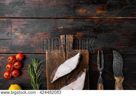 Raw Halibut Set, With Ingredients And Rosemary Herbs, On Old Dark  Wooden Table Background, Top View
