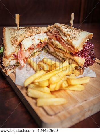 Club-sandwich With French Fries .