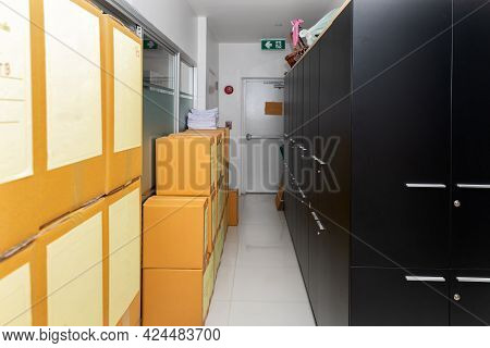 Cardboard Box With Products And File Cabinet In The Warehouse.
