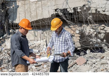 Demolition Control Supervisor And Contractor Discussing On Demolish Building.