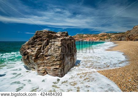 Rocks on Paleochori beach and waves of Aegean sea, Milos island, Cyclades, Greece. Slow motion