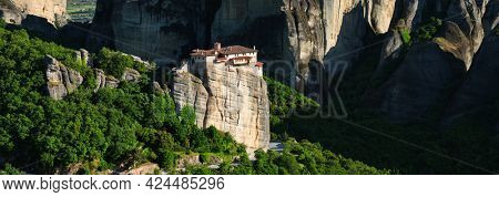 Panorama of Monastery of Rousanou in famous greek tourist destination Meteora in Greece on sunset with scenic landscape.
