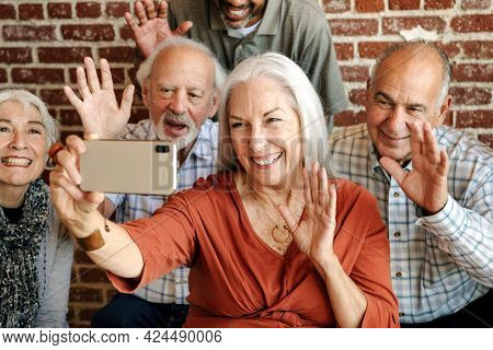 Old people waving to the video calling