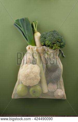 Fresh Vegetables And Fruits In A Reusable Fabric Eco Bag. Broccoli, Leeks, Cauliflower, Garlic, Avoc