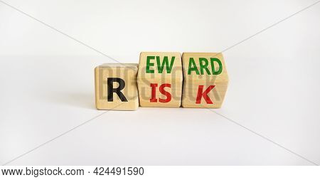 Risk Or Reward Symbol. Turned Wooden Cubes And Changed The Word 'risk' To 'reward'. Beautiful White