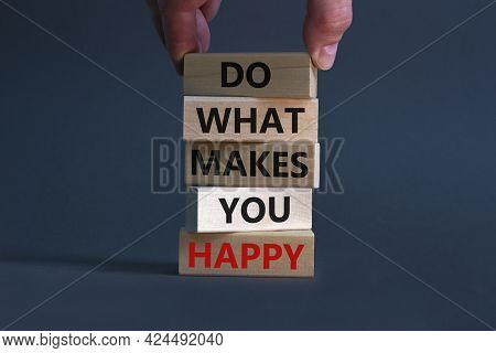 Do What Makes You Happy Symbol. Wooden Blocks With Words 'do What Makes You Happy'. Businessman Hand