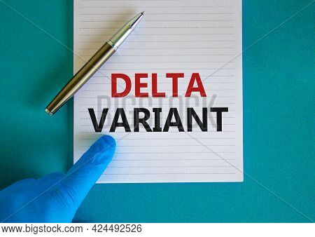 New Covid-19 Delta Variant Strain Symbol. Hand In Blue Glove With White Card. Concept Words 'delta V