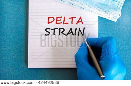 Covid-19 Delta Variant Strain Symbol. Doctor Hand In Blue Glove With Pen, White Card. Concept Words
