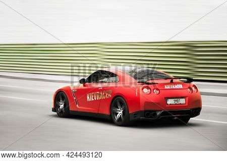Kiev, Ukraine - June 16, 2021: Red Nissan Gt-r R35 Supercar In Motion. Blurred Car. Nissan Gt-r At H