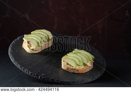 Sandwiches With Cheese And Avocado. Avocado Slices On Bread. Avocado Sandwiches On A Tray. Front Vie