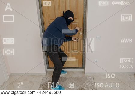 Crime Burglar In Black Mask Try To Break Door On House Apartments, The Secret Cctv Camera System