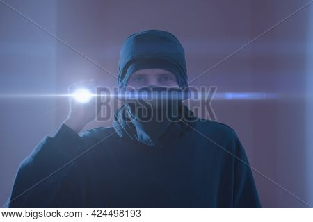 A Close Up Bandit Thief In The Mask With A Torch Light While Making A Crime