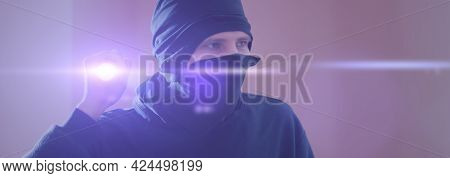 A Close Up Bandit Thief In The Mask With A Torch Light While Making A Crime Wide Banner Panorama
