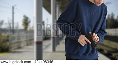 A Close Up Terrorist With A Black Pistol In Public Street Place Of The City