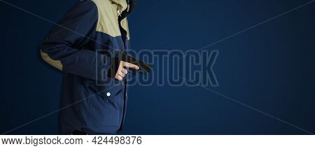A Crime Bandit With A Small Black Gun Isolated Against The Colourful Wall, Simple Abstract Outlaw Co