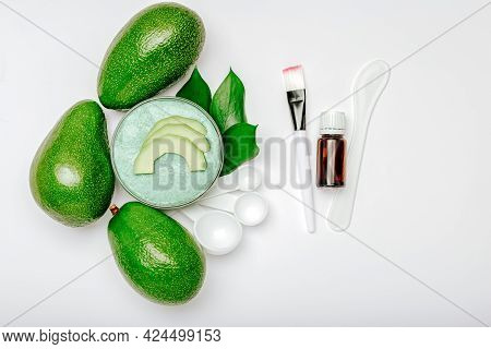 Skin Care Beauty Product Natural Organic Cosmetics Made From Avocado Fruit, Essential Oil On White B
