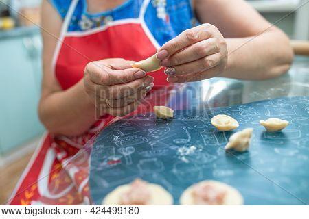 Women's Hands Sculpt Dumplings Close - Up At Home.