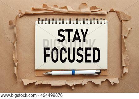 Stay Focused. Text In Notebook On Craft Background