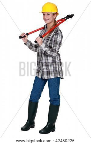 Tradeswoman carrying a pair of large clippers around her neck