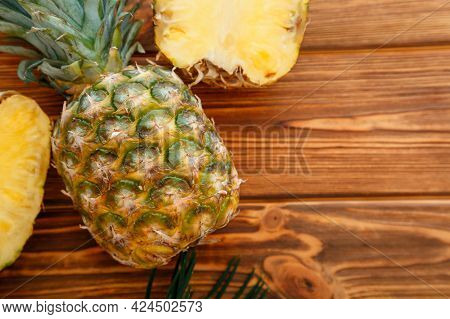 Ripe Pineapple. Tropical Summer Fruit Pineapple Sliced And Whole Pineapple On A Wooden Brown Dark Ta