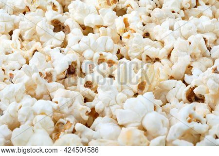 Heap Of Delicious Popcorn, On White Background. Scattered Popcorn Texture Background. Full Depth Of