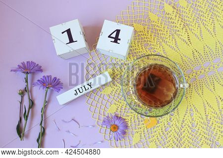 Calendar For July 14: Cubes With The Number 14, The Name Of The Month Of July In English , A Cup Of