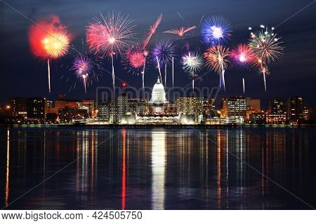 Skyline of Madison Wisconsin at night with fireworks over Lake Monona