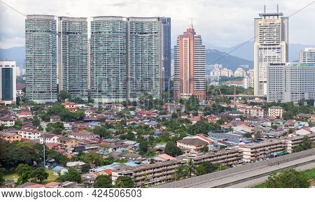 Kuala Lumpur, Malaysia - November 28, 2019: Kuala Lumpur Downtown View With Small Old And Tall New L