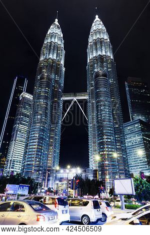 Kuala Lumpur, Malaysia - November 28, 2019: Petronas Twin Towers At Night, Vertical Street View Of K