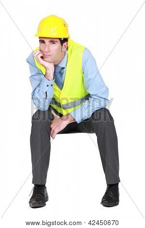 Bored engineer working on-site