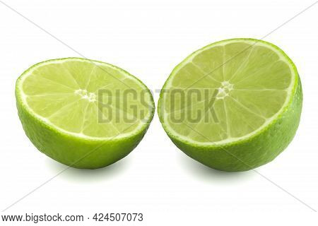 Two Halves Of Lime Isolated On White Background. Fresh Citrus Cut In Half. Green Fruit Full Focus